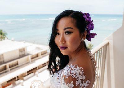 Nhu on a balcony next to the beach