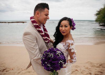 Nhu and her husband posing on the beach