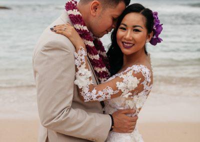 Nhu and her husband hugging on the beach