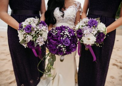 Nhu and her bridesmaids displaying their bouquets