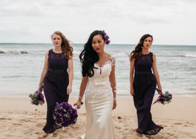 Nhu and her Bridesmaids standing together on the beach