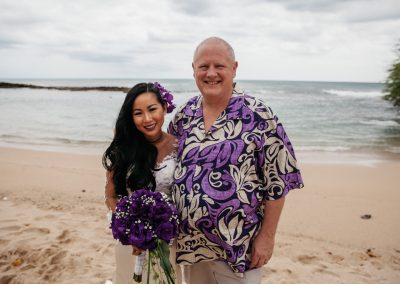 Nhu and Carl standing together on the beach