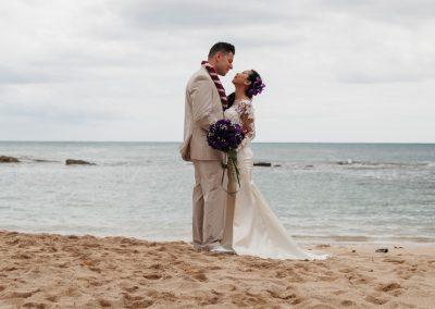 Nhu and her husband standing on the beach