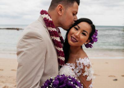 Nhu's husband kissing her head
