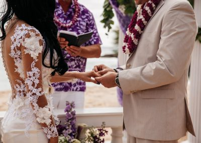 Nhu's husband placing the ring on her finger