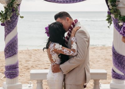 Nhu and her husband kissing at their wedding