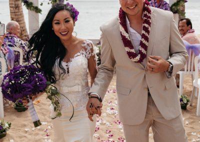 Nhu and her husband walking down the aisle