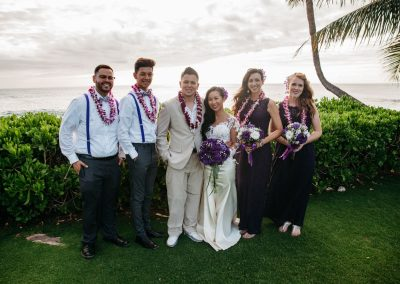 Nhu and her husband posing with their wedding party