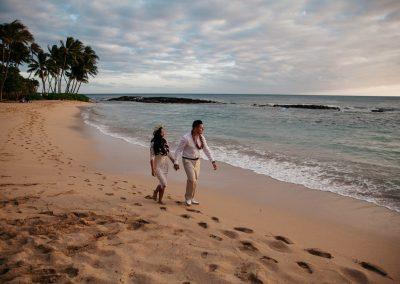 Nhu and her husband walking along a beach