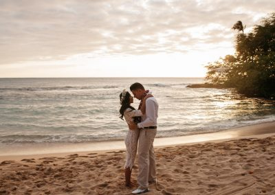 Nhu and her husband standing on a beach together