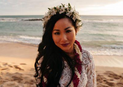 Nhu posing on a beach in her wedding dress