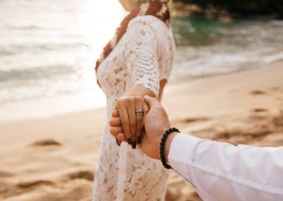 Nhu holding her husband's hand