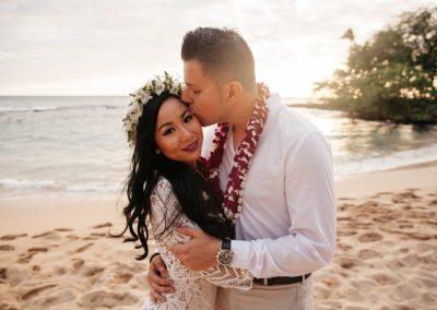 Nhu and her husband posing on a beach together