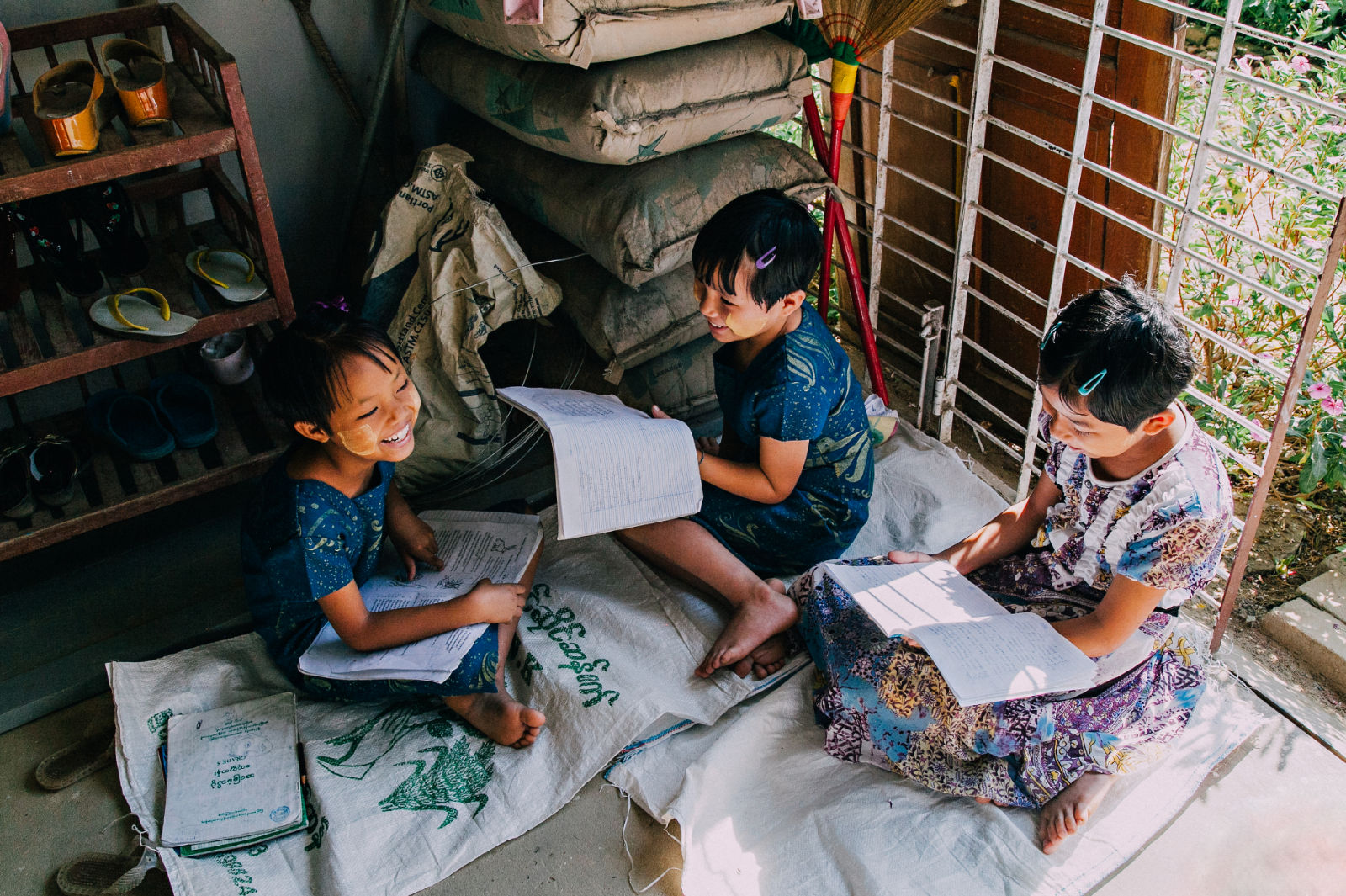 Three Girls studying together, this is why we work at Ending Child Sex Slavery through prevention