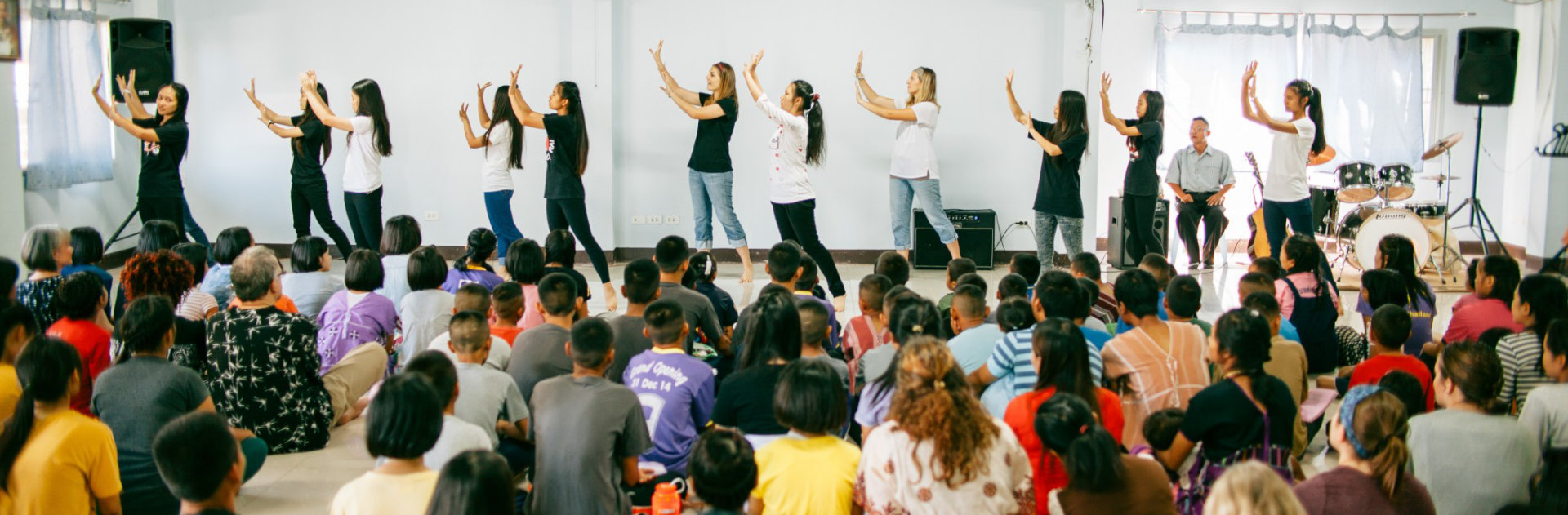 People dancing infront of a crowd